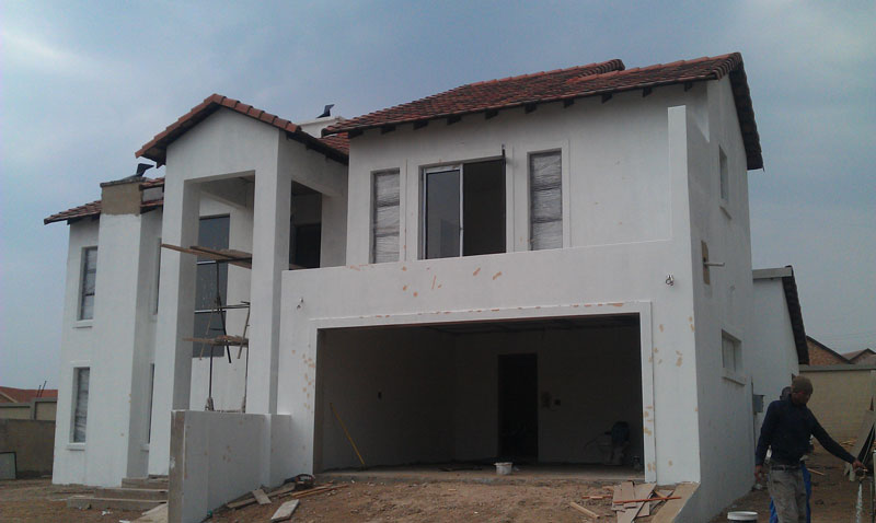 Builders completing a house construction Sigmadoors