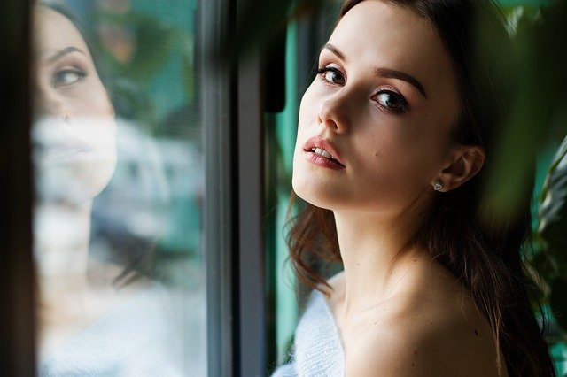 lady standing next to upvc windows Sigmadoors